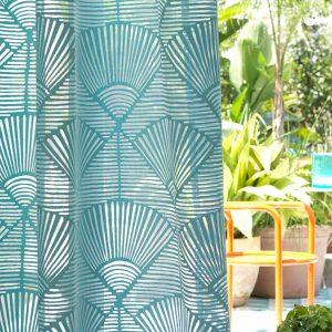 dettaglio tenda neruda via roma 60 in verde acqua con disegno marino