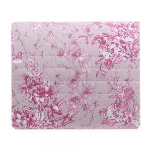dettaglio dall'alto del copriletto a fiori rosa su fondo grigio collezione Aster di Riviera